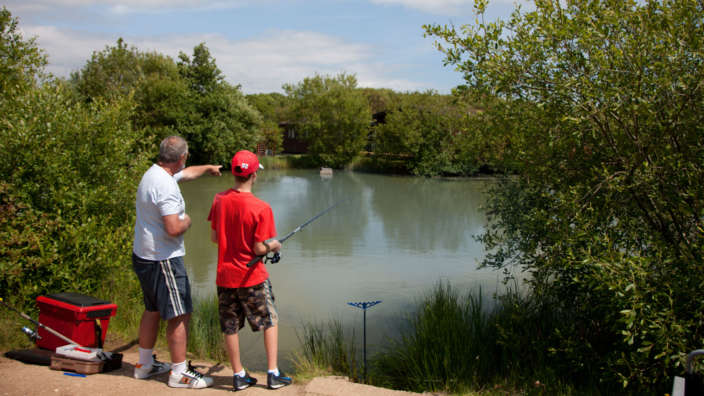 Father-and-son-fishing-at-Shorefield-Country-Park