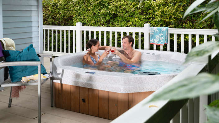 Couple drinking wine in hot tub review