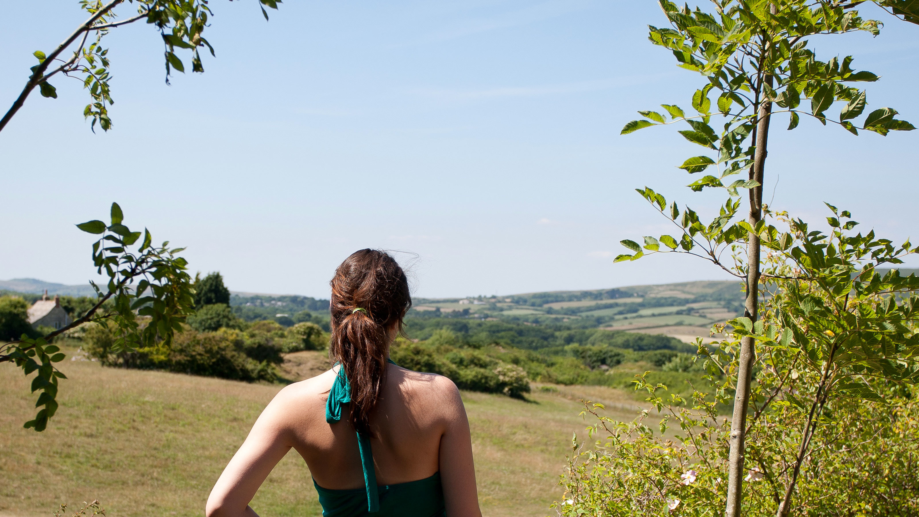 Woman walking through Swanage countryside in Dorset