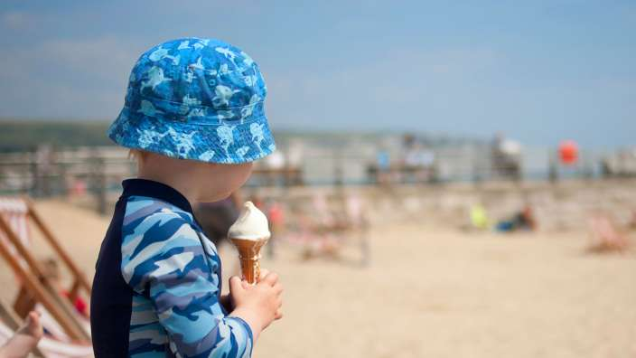 1 Young Boy Eating An Ice Cream At Swanage Beach