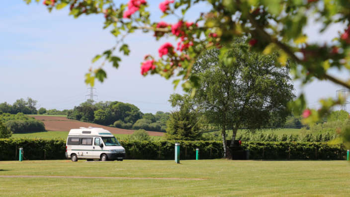 1 Campervan On A Serviced Grass Pitch In Summer