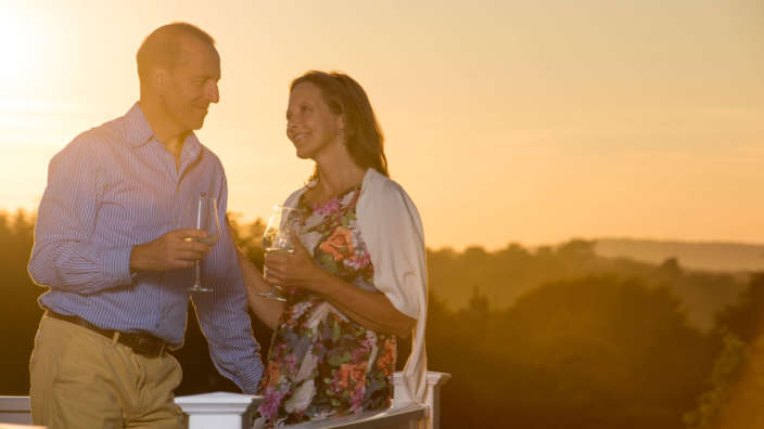 Couple Drinking Wine At Sunset Scenic