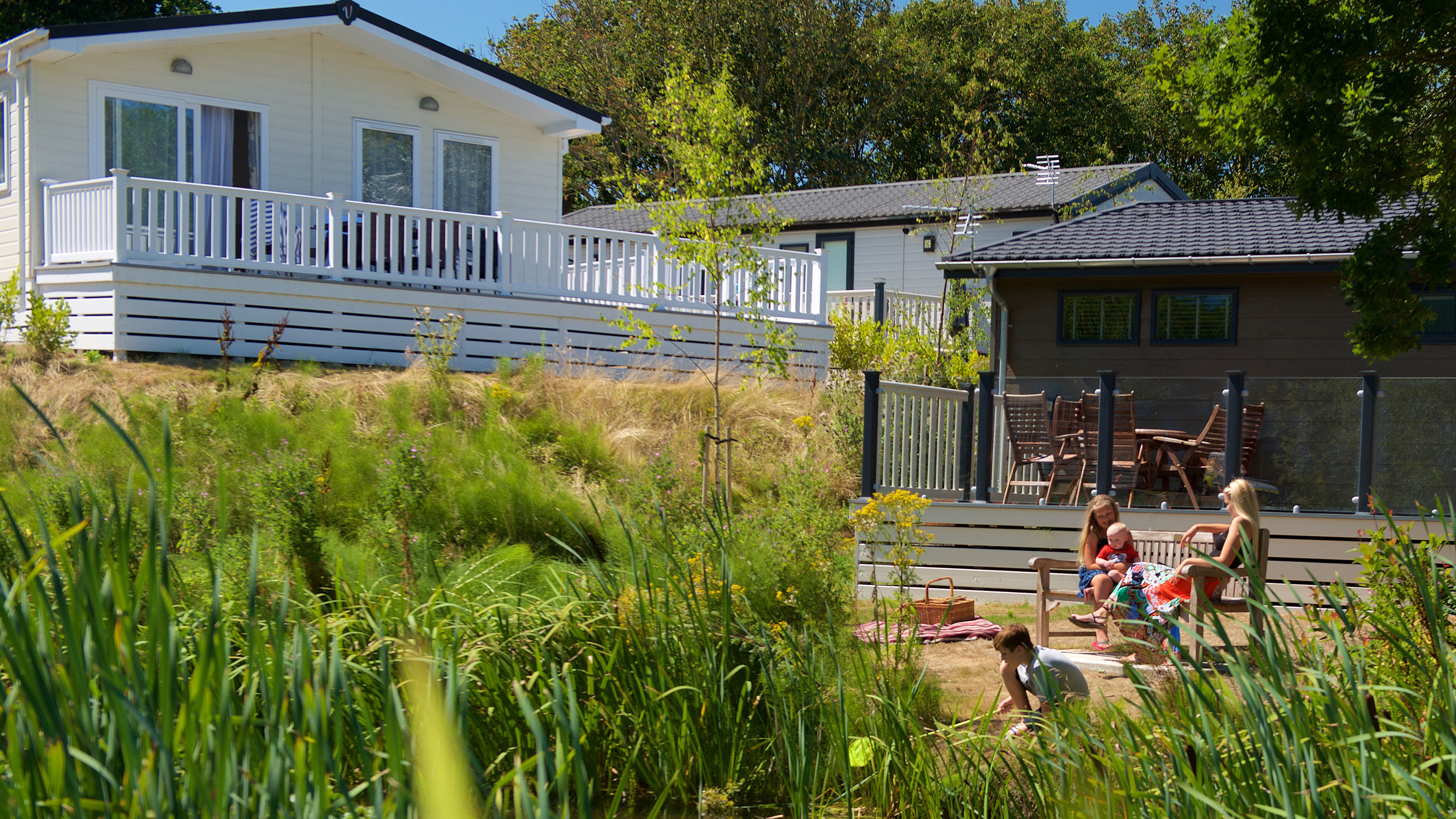 Children Relaxing Outside Holiday Home Summer Picnic