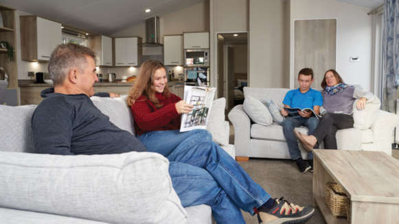Family-Sitting-Sofas-Reading-Talking