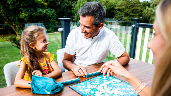 Family Decking Playing Scrabble