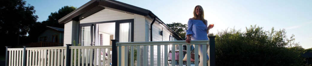 Woman on decking of holiday home