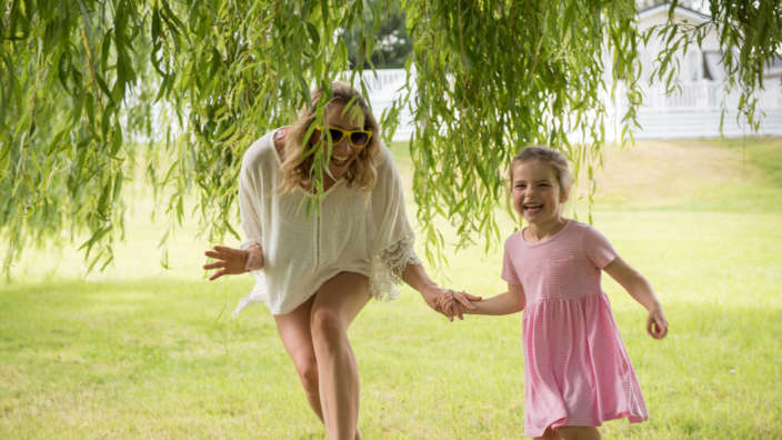 Mother-daughter-woods-laughing
