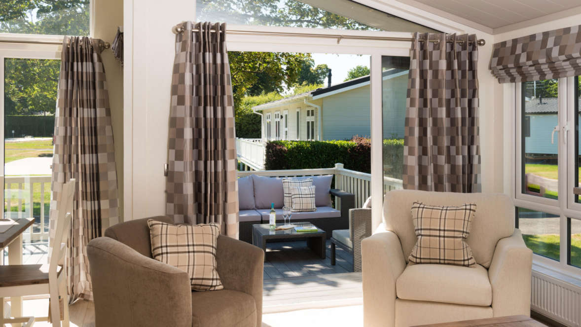 Lodges with luxury interiors at Merley Court Holiday Park