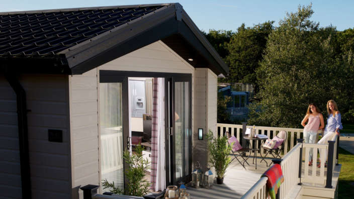 Family on decking of New Forest holiday home