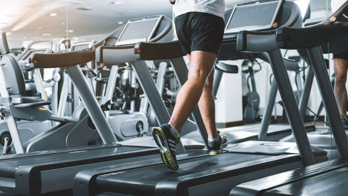 Man Running On Gym Treadmill Shorefield Fitness Club