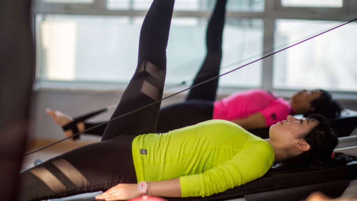 Woman Excercising At Health At Fitness Club