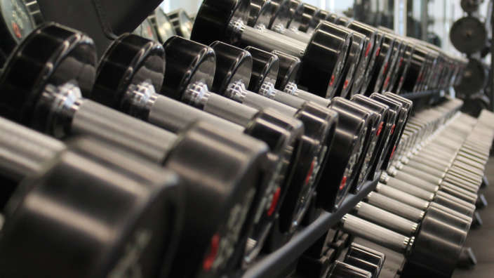 Dumbells On Rack At Fitness Club