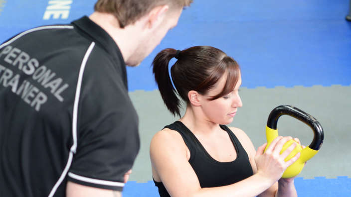 Woman Personal Training With Kettlebell