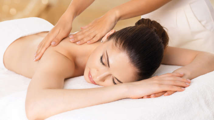 Woman Receives A Relaxing Back Massage
