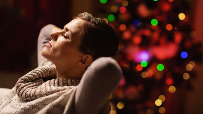 Woman Relaxing Christmas Tree